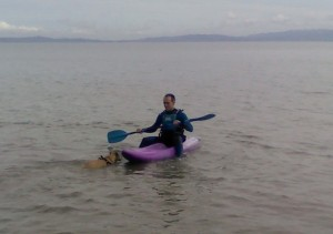 Tazmin swimming out to the kayak in the Firth of Thames